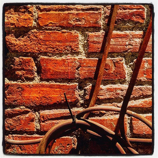 Old Brick Texture with Worn Air Hose