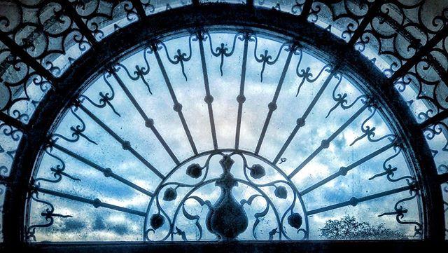 Ironwork with Clouds Beyond